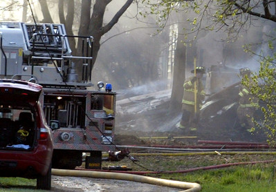 H. Rick Bamman - hbamman@shawmedia.com Firefighters work the scene of a house fire that started about 4 p.m. Wednesday afternoon at 17N998 Sandwald Rd. in Huntley. The single family two-story home was destroyed. Water had to be trucked in as ther were not hydyants near the property.