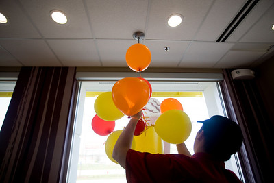 Jenny Kane - jkane@shawmedia.com McDonald's crew member Dylan Woods takes down balloon from the lobby. It was McDonald's Grand opening at their new location on S. Route 31 in McHenry.