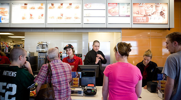 Jenny Kane - jkane@shawmedia.com McDonald's employees Amanda Tonyan, (left) Chris Martin, (center) and Jennifer Popejoy, (right) take orders during the lunch rush. It was McDonald's Grand opening at their new location on S. Route 31 in McHenry.