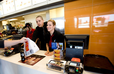 Jenny Kane - jkane@shawmedia.com McDonald's shift managers Chris Martin, (left) and Jennifer Popejoy, (right) finish taking an order during the lunch rush. It was McDonald's Grand opening at their new location on S. Route 31 in McHenry.