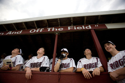 Jenny Kane - jkane@shawmedia.com Prairie Ridge's dugout watches pop-fly hit over left field go out of bounds during their non-conference game against Fremd. Prairie Ridge lost to Fremd 9-10.