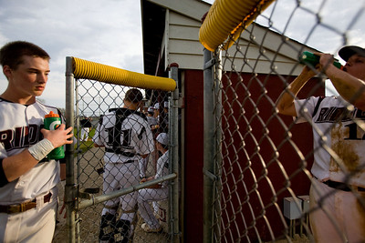 Jenny Kane - jkane@shawmedia.com Prairie Ridge varsity baseball team grabs a drink while they prepare to go to bat against Fremd during a non-conference match-up. Prairie Ridge lost to Fremd 9-10.