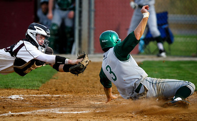 Jenny Kane - jkane@shawmedia.com Prairie Ridge catcher Matt Krenz tries tag Fremd's Josh Jyawook out as he tries to steal home during the top of the second inning in their non-conference match-up.