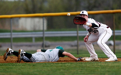 Jenny Kane - jkane@shawmedia.com Prairie Ridge's first baseman Mike Hallstrom tries to make a pick off against Fremd's Danny Haduch during their non-conference game. Prairie Ridge lost to to Fremd 9-10.