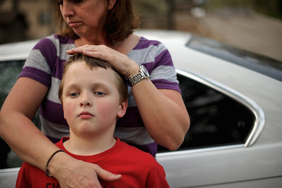 Daniel J. Murphy - dmurphy@shawmedia.com  Brenda Hartmann embraces her son Ben, 8, in the driveway of their home Thursday March 22, 2012 in Wonder Lake. The Hartman family is always on the go. They have four kids ranging from 8 to 16 and all participate in some sort of sport. To keep track of their busy schedule, the family has a color-coded calendar in their house.