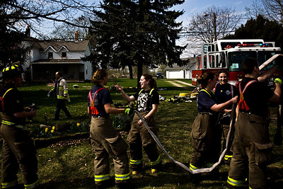 Lance Booth - lbooth@shawmedia.com Firefighters of the Spring Grove Fire Department put away the hose after helping to put out the fire at 10105 Winn Road in Spring Grove on Thursday, March 22, 2012. No injuries were reported and the cause of the fire has yet to be determined.