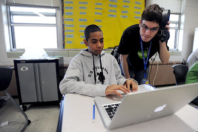 Sarah Nader - snader@shawmedia.com Eight-grader T.J. Young (left), 14, of Harvard gets help from McHenry County College digital media student Christian Andrick, 19, of Algonquin during the Storycatchers program at Harvard Junior High School on Thursday, March 22, 2012. Friends of McHenry County College Foundation received the 2011 Empowerment Grant to start the Storycatchers program from Motorola last year. The program helps expand the students story telling skills by using Mac laptops to create a story about themselves using photos, animation and sound effects.