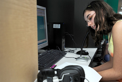 Sarah Nader - snader@shawmedia.com Eight grader Breanna Pauli, 13, of Harvard records audio while working with McHenry County College digital media students during the Storycatchers program at Harvard Junior High School on Thursday, March 22, 2012. Friends of McHenry County College Foundation received the 2011 Empowerment Grant to start the Storycatchers program from Motorola last year. The program helps expand the students story telling skills by using Mac laptops to create a story about themselves using photos, animation and sound effects.