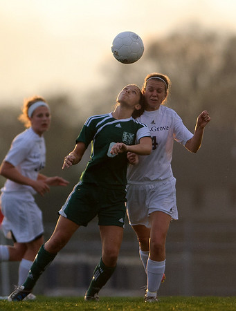Daniel J. Murphy - dmurphy@shawmedia.com  Boylan forward Maura Korchak (left) and Cary-Grove defender Michelle Kalenda (right) go after the ball in the first half Friday March 23, 2012 at Cary-Grove High School in Cary. Boylan Catholic defeated Car-Grove 2-1.