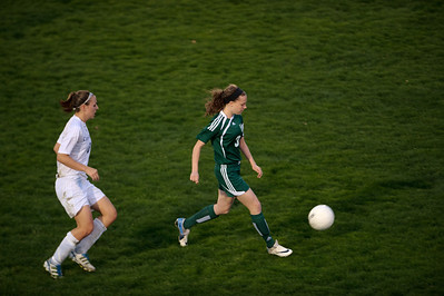 Daniel J. Murphy - dmurphy@shawmedia.com  Boylan defender Mackenzie Fray (right) moves the ball past Cary-Grove defender Sierra Romero (left) in the second half Friday March 23, 2012 at Cary-Grove High School in Cary. Boylan Catholic defeated Car-Grove 2-1.