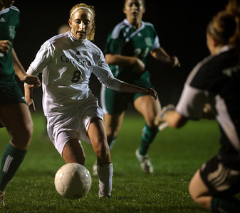 Daniel J. Murphy - dmurphy@shawmedia.com  Cary-Grove midfielder Liz Koch (center) attempts a shot on goal past Boylan goalie Shelby Sonnefeldt (right) in the second half Friday March 23, 2012 at Cary-Grove High School in Cary. Boylan Catholic defeated Car-Grove 2-1.