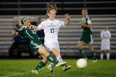 Daniel J. Murphy - dmurphy@shawmedia.com  Boylan forward Emma Krahmer (left) and Cary-Grove defender Megan Townsley (right) fight for the ball in the second half Friday March 23, 2012 at Cary-Grove High School in Cary. Boylan Catholic defeated Car-Grove 2-1.