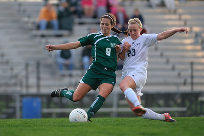 Daniel J. Murphy - dmurphy@shawmedia.com  Boylan midfielder Sydney Rumple (left) and Cary-Grove midfielder Kate Boyd (right) fight for the ball in the first half Friday March 23, 2012 at Cary-Grove High School in Cary. Boylan Catholic defeated Car-Grove 2-1.