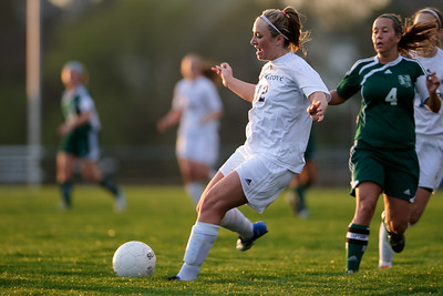 Daniel J. Murphy - dmurphy@shawmedia.com  Cary-Grove midfielder Brittany Loehner (left) moves the ball past Boylan's Alexa Wright (right) in the first half Friday March 23, 2012 at Cary-Grove High School in Cary. Boylan Catholic defeated Car-Grove 2-1.