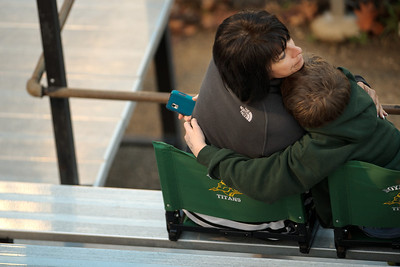 Daniel J. Murphy - dmurphy@shawmedia.com  Teresa White of Orlando, FL (left) hugs her nephew Reid Walter of Rockford during the Boylan/Cary-Grove game Friday March 23, 2012 at Cary-Grove High School in Cary. Boylan Catholic defeated Car-Grove 2-1.