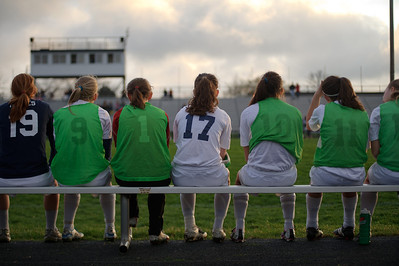 Daniel J. Murphy - dmurphy@shawmedia.com  Cary-Grove players watch from the sideline in the first half Friday March 23, 2012 at Cary-Grove High School in Cary. Boylan Catholic defeated Car-Grove 2-1.