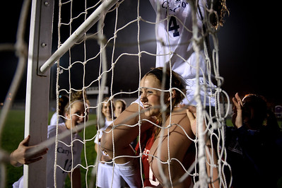 Daniel J. Murphy - dmurphy@shawmedia.com  Cary-Grove goalkeeper Paige Lincicum (lower) helps teammate Sierra Romero (top) take down the net after the game Friday March 23, 2012 at Cary-Grove High School in Cary. Boylan Catholic defeated Car-Grove 2-1.