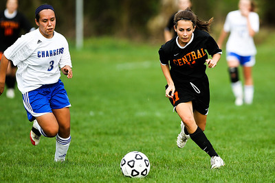 Lance Booth - lbooth@shawmedia.com Crystal Lake Central's Stacie Wolfgram goes down the field while Dundee-Crown's Ruby Moran tries to get the ball on Friday, March 23, 2012. Crystal Lake Central defeated Dundee-Crown with a final score of 4-0.