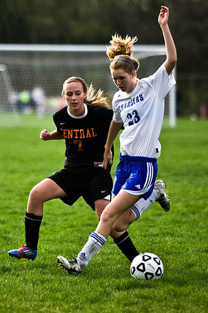 Lance Booth - lbooth@shawmedia.com Crystal Lake Central's Morgan Bertalonon and Dundee-Crown's Jill Wiechmann fight for the ball on Friday, March 23, 2012. Crystal Lake Central defeated Dundee-Crown with a final score of 4-0.