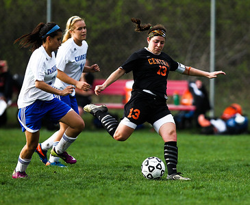 Lance Booth - lbooth@shawmedia.com Crystal Lake Central's Madie Edwardson kicks the ball on Friday, March 23, 2012. Crystal Lake Central defeated Dundee-Crown with a final score of 4-0.
