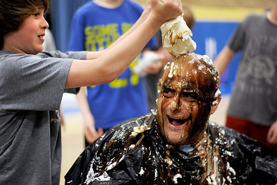 Sarah Nader - snader@shawmedia.com Gio Calabrese (left), 11, of Wonder Lake squeezes a carton of ice cream onto vice principal Chris Wolk while making him into a human sundae during the last day of spirit week at Harrison School in Wonder Lake on Friday, March 23, 2012. Calabrese's mother won the auction item to make Wolf into an ice cream sundae for $20 during Harrison PTO's pasta dinner fundraiser earlier this month. Over 5 thousand dollars was raised for the PTO.