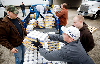 Jenny Kane - jkane@shawmedia.com Volunteer Shane Nervy of J.A. Frate, (right) adds a case of wet cat food onto a pile for Rich Walkowiak, (left) to load into a truck for Tails Humane Society. The volunteers helped load over 44,000 lbs of wet cat food was donated for 36 local rescue organizations by Purina's Pets for People organization at J.A. Frate in Crystal Lake. Each crate has 800 lbs of wet cat food.