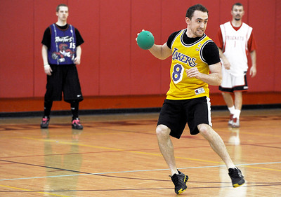 Sarah Nader - snader@shawmedia.com Chris Mims, 21, of Hoffman Estate gets ready to throw his ball while participating in the Spring String Charity Dodgeball Tournament in Island Lake on Saturday, March 24, 2012. Proceeds from the game helped to benefit Curesearch for Children's Cancer.