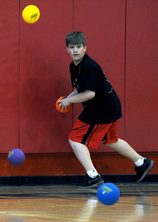 Sarah Nader - snader@shawmedia.com Dylan Oaks, 14, of Port Barrington tries to dodge all the balls while participating in the Spring String Charity Dodgeball Tournament in Island Lake on Saturday, March 24, 2012. Proceeds from the game helped to benefit Curesearch for Children's Cancer.