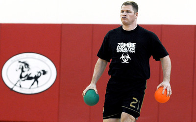Sarah Nader - snader@shawmedia.com Eric Hunt, 25, of McHenry grabs two balls while participating in the Spring String Charity Dodgeball Tournament in Island Lake on Saturday, March 24, 2012. Proceeds from the game helped to benefit Curesearch for Children's Cancer.