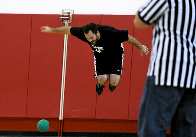 Sarah Nader - snader@shawmedia.com Chris Jackowiak, 25, of McHenry jumps to avoid the ball while participating in the Spring String Charity Dodgeball Tournament in Island Lake on Saturday, March 24, 2012. Proceeds from the game helped to benefit Curesearch for Children's Cancer.