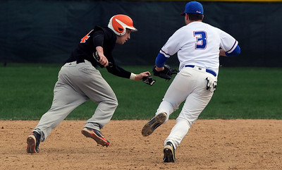 Sarah Nader - snader@shawmedia.com Dundee-Crown's Nick Hathon (right) tags out St. Charles East's Troy DeFilippis while he ran back to second after trying to steal to third during the third inning of Monday's game on March 26, 2012. St. Charles East won, 11-1.