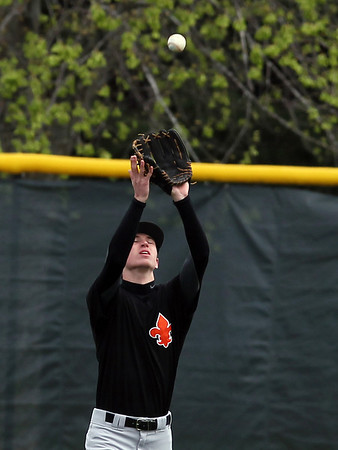 Sarah Nader - snader@shawmedia.com St. Charles East's Nathan Sharko catches a fly ball to right field during the third inning of Monday's game against Dundee-Crown in  Carpentersville on March 25, 2012. St. Charles East won, 1-11.