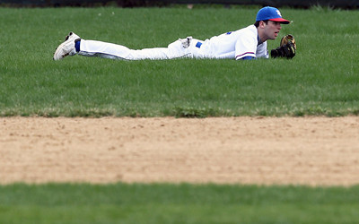 Sarah Nader - snader@shawmedia.com Dundee-Crown's Trent Muscat lays in the grass after diving for the ball during the fourth inning of Monday's game against St. Charles East  in Carpentersville on March 25, 2012. Dundee-Crown lost, 1-11.