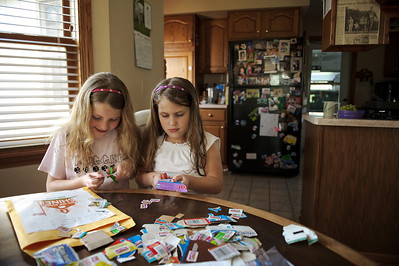 Daniel J. Murphy - dmurphy@shawmedia.com  Emily Willis, 7, (left) and her sister Sara, 5, (right) cut out box tops Tuesday March 27, 2012 at the Willis home in Union. Their mother Anitra Willis is the Box Tops 4 Education coordinator for Leggee School in Huntley, which is a top producer in the state.