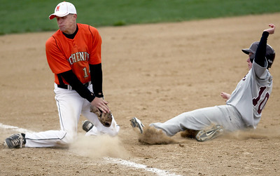Sarah Nader - snader@shawmedia.com Richmond-Burton's Eric Hohs (right) slides safely into third while McHenry's Nick Svoboda waits for the ball during the third inning of Tuesday's game in McHenry on March 27, 2012. Richmond-Burton won, 6-1.