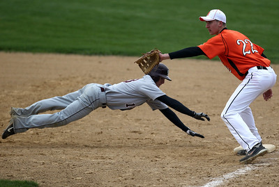 Sarah Nader - snader@shawmedia.com Richmond-Burton's Evan Giacomo (left) slides back into first while McHenry's Jamie Rammel waits for the pass during Tuesday's game in McHenry on March 27, 2012. Richmond-Burton won, 6-1.