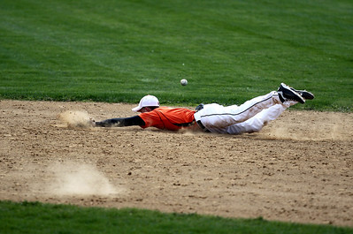 Sarah Nader - snader@shawmedia.com McHenry's Kyle Clark dives for a ground ball during Tuesday's game against Richmond-Burton on March 27, 2012. Richmond-Burton won, 6-1.