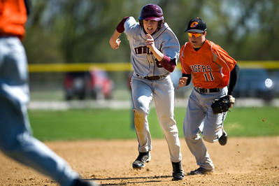 Daniel J. Murphy - dmurphy@shawmedia.com  Crystal Lake Central's Nathan Klyczek (right) chases down Marengo's Jesse Darlington for an out on his way to third base in the fourth inning Wednesday March 28, 2012 at Marengo High School in Marengo. Marengo defeated Crystal Lake Central 8-4.