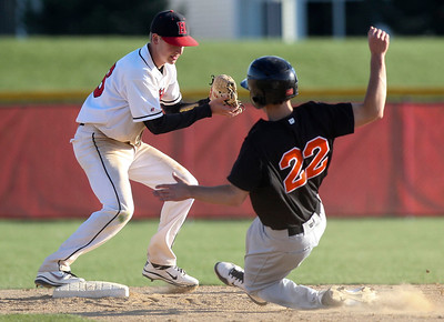 Jenny Kane - jkane@shawmedia.com Huntley's Jordan Chuipek makes the forced out at second as DeKalb's Brian Sisler tries to slide into the base. It was the third out in the top of the sixth inning.