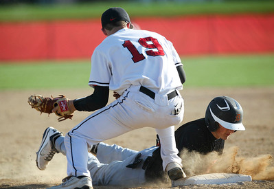 Jenny Kane - jkane@shawmedia.com Huntley's Kameron Sallee tries to make a pick off at first base as DeKalb's Tyler Gosnell slides safely back. Huntley defeated DeKalb 2-1.