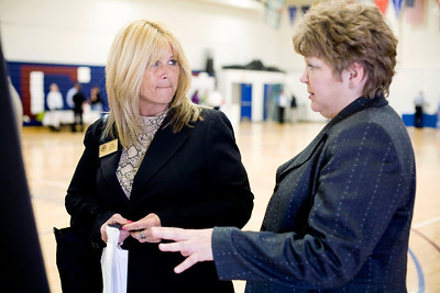 Jenny Kane -jkane@nwherald.com Huntley Chamber member Rita Slawek speaks to county auditor Pam Palmer during the McHenry County Business to Government Plug-In Event at McHenry County College. It was a chance for businesses around the area to meet government agencies face to face instead of making a cold call. There were thirty booths, and over 100 participants.