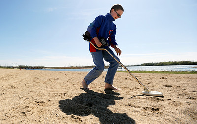 Sarah Nader - snader@shawmedia.com With a metal detector in hand Billy Husen, 12, of Crystal Lake searches for treasure at Three Oaks Recreation Area in Crystal Lake on Wednesday, March 28, 2012. Pennies, nails and some little plastic toys were the only things that he had found on his second time hunting for treasure.