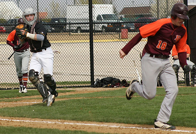 Mike Greene - For the Northwest Herald Jacobs' Greg Sidor (left) fields a bunt by Brother Rice's Neil Gallagher during a varsity game Saturday in Algonquin. The Eagles lost to the Crusaders 4-3.