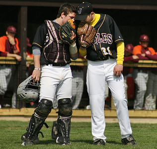 Mike Greene - For the Northwest Herald Jacobs' Greg Sidor (left) and Greg Mixon have a conversation on the mound during a game against Brother Rice Saturday in Algonquin. The Eagles lost to the Crusaders 4-3.