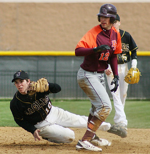 Mike Greene - For the Northwest Herald Jacobs' Matt Hickey (left) holds up his glove to show the ball after Brother Rice's Garrett O' Neill slid into second base Saturday in Algonquin. O' Neill was safe on the play.
