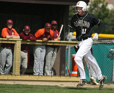 Mike Greene - For the Northwest Herald Jacobs' Max Rider trots home after a two-run home run during a game against Brother Rice Saturday in Algonquin. Rider drove in three runs in the Eagles loss to the Crusaders 4-3.