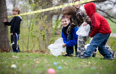 Jenny Kane - jkane@shawmedia.com From left to right, Payton Dougherty, Jack Covell and Mark Duenas,  discuss the plans on how to get the most eggs before the Woodstock Jaycees's annual Easter Egg Hunt at the Hilltop Pavilion at Emricson Park in Woodstock on Saturday.