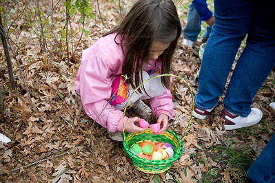 Jenny Kane - jkane@shawmedia.com Madison Kentgen, 7, of Woodstock, opens up the eggs she found during the Woodstock Jaycees's annual Easter Egg Hunt at the Hilltop Pavilion at Emricson Park in Woodstock on Saturday.
