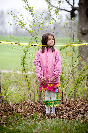 Jenny Kane - jkane@shawmedia.com Madison Kentgen, 7, of Woodstock, waits in front of the easter egg area for the 7 to 10-year-olds before the Woodstock Jaycees's annual Easter Egg Hunt began.