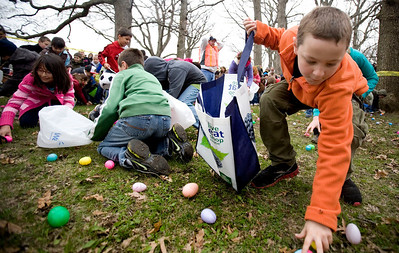 Jenny Kane - jkane@shawmedia.com Tristan Carter, (right) gathers eggs during the Woodstock Jaycees's annual Easter Egg Hunt at the Hilltop Pavilion at Emricson Park in Woodstock on Saturday.